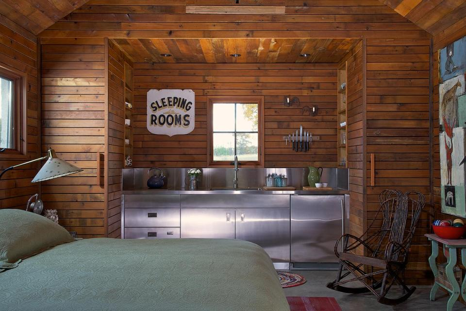 A small studio cabin with compact kitchen and bath in 350 sq ft. | www.facebook.com/SmallHouseBliss