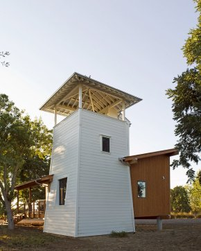 This small cabin modeled on old-fashioned water towers has 1 bedroom and a loft. | www.facebook.com/SmallHouseBliss