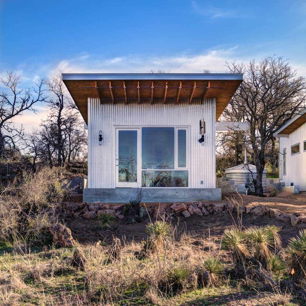 Llano exit strategy a shared cabin compound matt garcia for Micro cottage builders