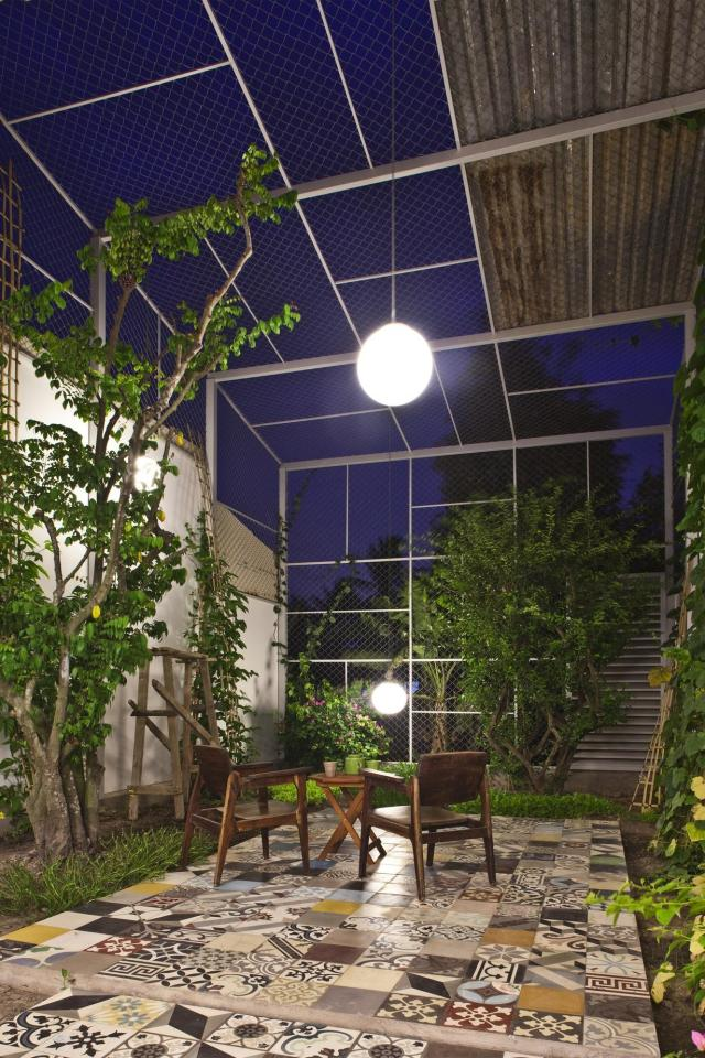 This small house in Vietnam has its ground floor living space open to the outdoors. It will eventually be covered by a screen of climbing plants. | www.facebook.com/SmallHouseBliss