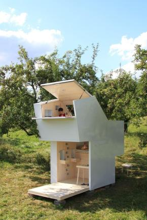 """The """"Spirit Shelter"""", a tiny structure designed for self-reflection, has lofted bed and study spaces that cantilever over the main floor. 