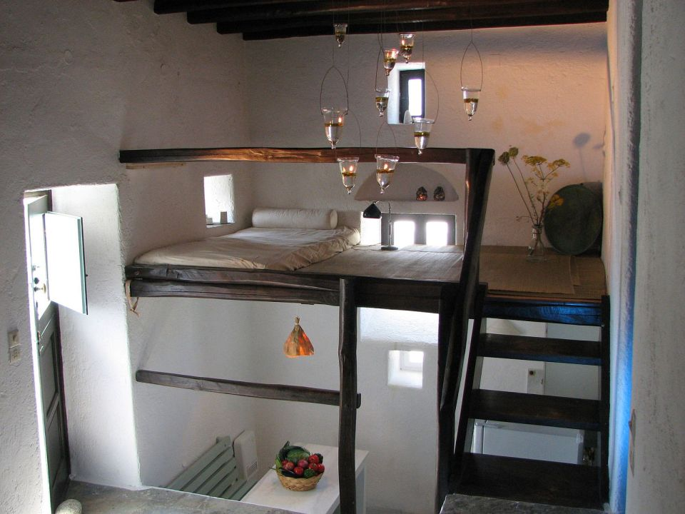 A traditional house on Mykonos was restored, staying true to the island's architectural history. It has two bedrooms and a loft in 840 sq ft.   www.facebook.com/SmallHouseBliss