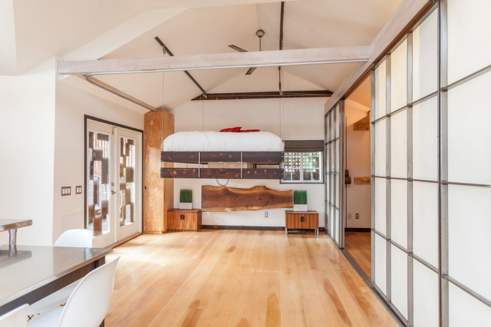 "Mad Men actor Vincent Kartheiser's Hollywood pad with a ""Japanese industrial"" aesthetic. The 603 sq ft studio features a bed that drops from the ceiling. 
