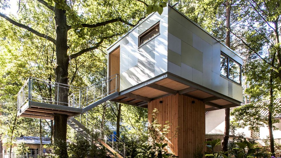 A pair of modern treehouses at the edge of a forest provide leafy retreats complete with kitchenette and bath. | www.facebook.com/SmallHouseBliss