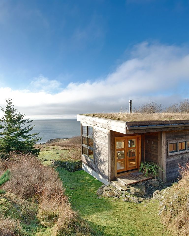 With a sod roof and weathered cedar siding, Eagle Point cabin blends with the San Juan Island landscape. It has 1 bedroom in 688 sq ft. | www.facebook.com/SmallHouseBliss