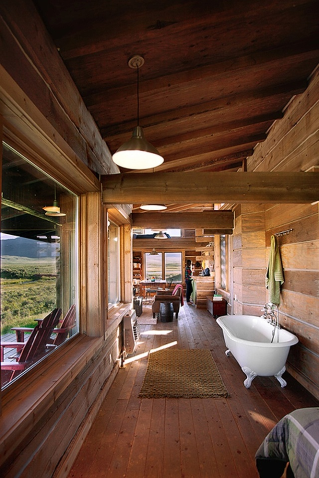 Little Lost Cabin, a small square-log cabin on 3,700 acres of Idaho ranchland. The 800 sq ft cabin has an open bedroom and a loft. | www.facebook.com/SmallHouseBliss