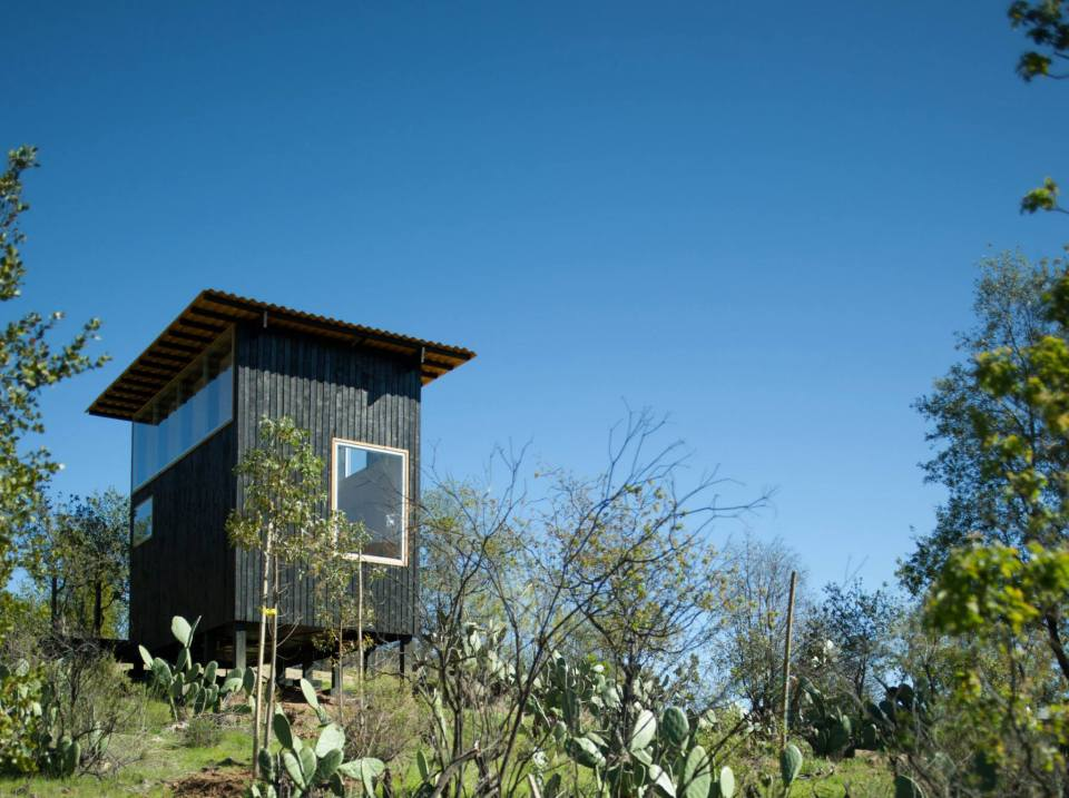 Charred cabin a place to eat sleep and read for two for Small footprint cabin