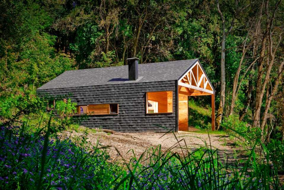 """""""Casa Bote"""" is a dual-use structure, serving as a cabin in the summer and a boat storage shed over the winter. 