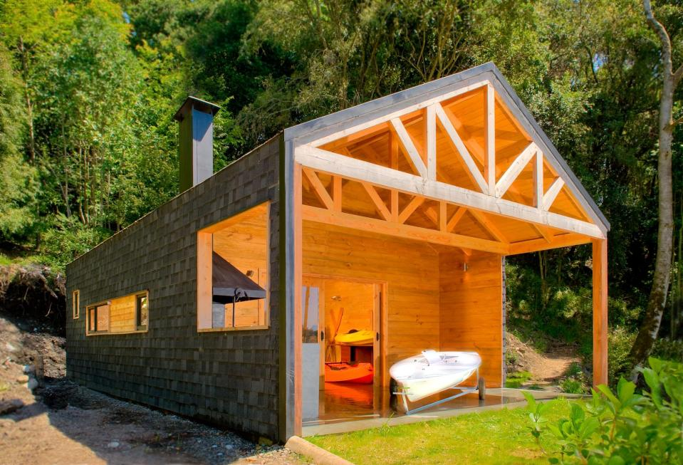 """Casa Bote"" is a dual-use structure, serving as a cabin in the summer and a boat storage shed over the winter. 