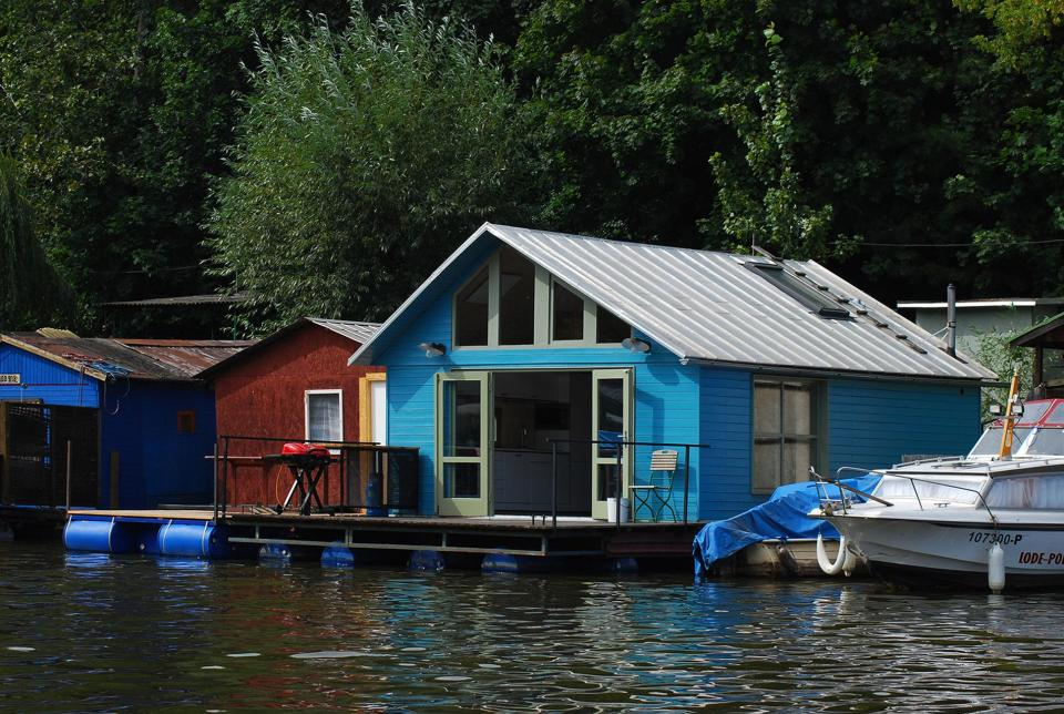 An old houseboat moored along a Prague riverbank was given a contemporary redesign. | www.facebook.com/SmallHouseBliss