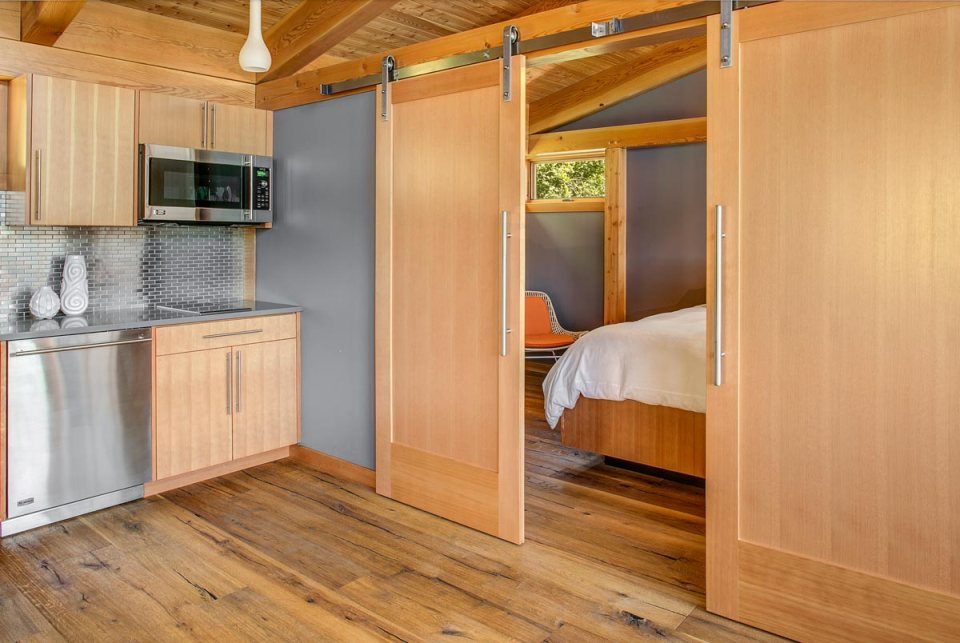 This timber framed cabin has modern lines and an energy-efficient shell. There is 1 bedroom in 550 sq ft. | www.facebook.com/SmallHouseBliss