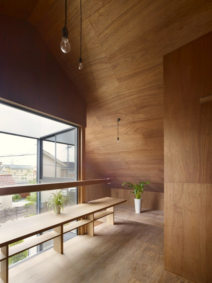 This small family home has an austere appearance but the wood-lined interior is warm and intimate. | www.facebook.com/SmallHouseBliss