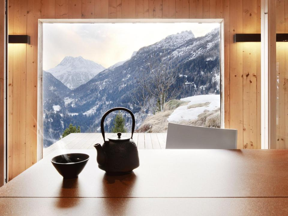 A WW II-era munitions storage building in the Swiss Alps was converted into this modern cabin with a 527 sq ft studio floor plan. | www.facebook.com/SmallHouseBliss