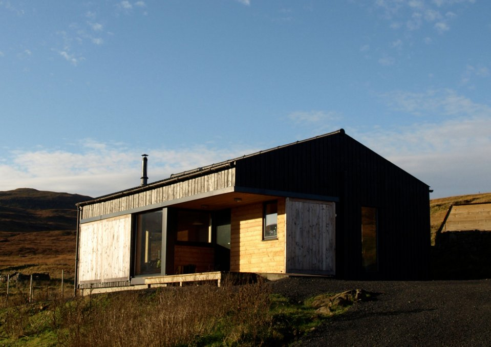 The Black Shed, a simple farm cottage on the Isle of Skye inspired by the storage building it replaced. It has 2 bedrooms in 807 sq ft.   www.facebook.com/SmallHouseBliss