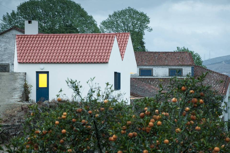 This caretaker's residence on a vineyard in Portugal was designed to complement the older buildings on the site. It has 2 bedrooms in 753 sq ft. | www.facebook.com/SmallHouseBliss