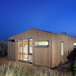 This vacation cottage sits on the sand dunes of a Dutch coastal island. It has two small bedrooms in 646 sq ft.   www.facebook.com/SmallHouseBliss