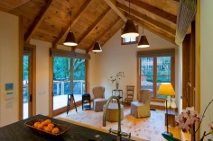 This rustic guest cabin features extensive custom interior woodwork. It has one bedroom and a sleeping loft in 714 sq ft. | www.facebook.com/SmallHouseBliss