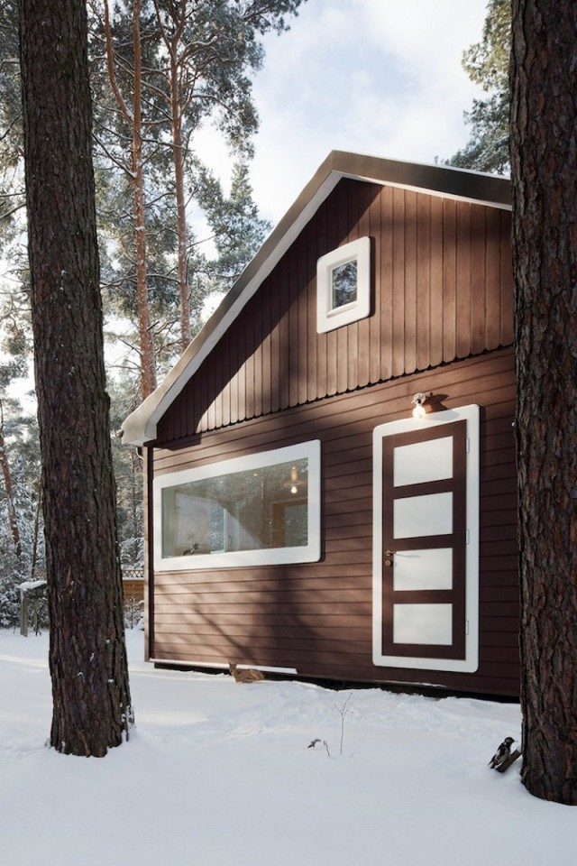 """A small """"gingerbread house"""" in the forest. The 667 sq ft cottage has a loft divided into two sleeping spaces. 
