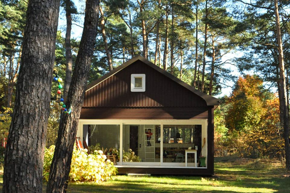 "A small ""gingerbread house"" in the forest. The 667 sq ft cottage has a loft divided into two sleeping spaces. 