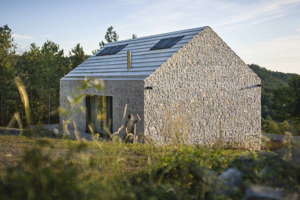 This stone and concrete cottage is an update of traditional stone houses in the area. Designed for a family of 4, the house has 2 bedrooms in 990 sq ft. | www.facebook.com/SmallHouseBliss