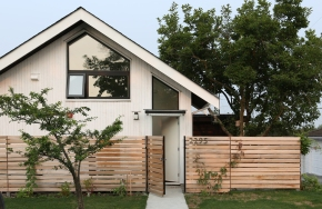 Magnolia Tree Lane House, a stylish new laneway house, has a reverse floor plan with 1 bedroom in 670 sq ft. | www.facebook.com/SmallHouseBliss