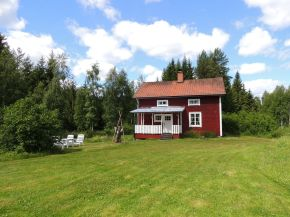 This hundred-year-old farmhouse in the Swedish countryside retains much of its original interior and character. It has 3 bedrooms in roughly 1,020 sq ft. | www.facebook.com/SmallHouseBliss