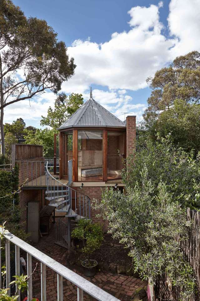 """The """"Tardis"""", a tiny tower house built within an existing backyard structure. 