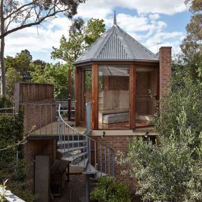 "The ""Tardis"", a tiny tower house built within an existing backyard structure. 