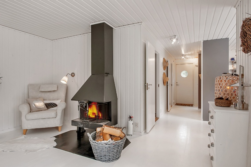 This simple cottage in the Swedish countryside has 2 bedrooms. A monochromatic color scheme makes it appear more spacious than its 614 sq ft. | www.facebook.com/SmallHouseBliss