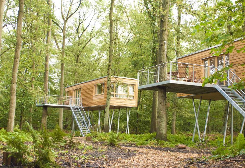 The Baumgeflüster treehouse resort in Germany. Each treehouse has one bedroom in 383 sq ft. | www.facebook.com/SmallHouseBliss