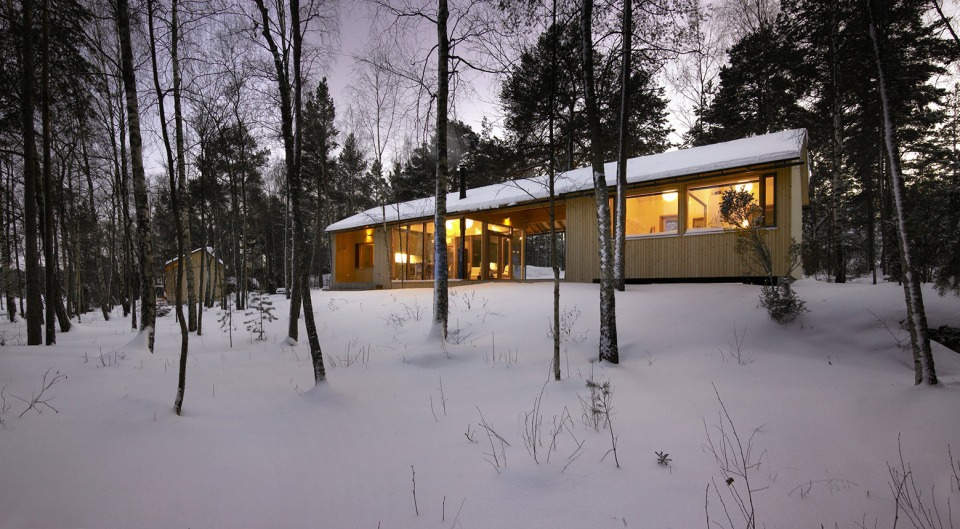 This small family vacation cabin combines a dogtrot floor plan with a ...