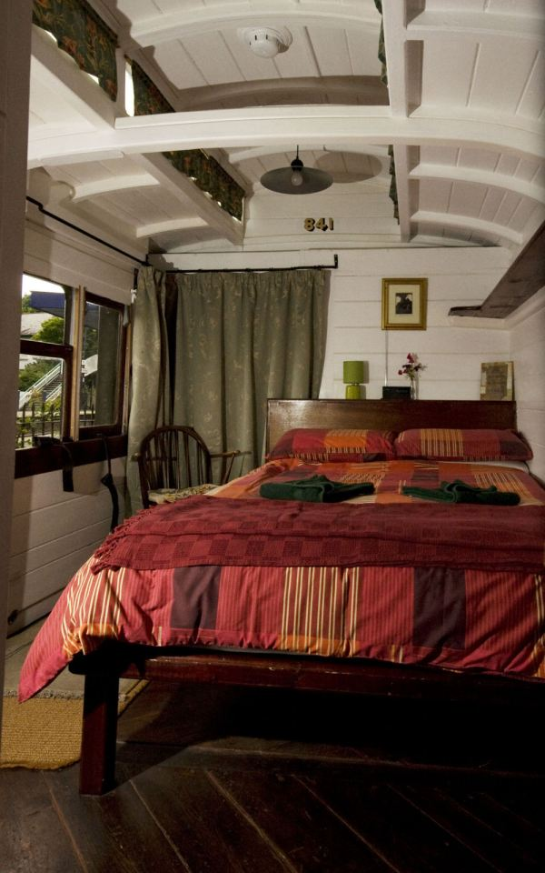 The Travelling Post Office, a Victorian-era railcar converted into a self-contained two bedroom vacation rental suite. | www.facebook.com/SmallHouseBliss