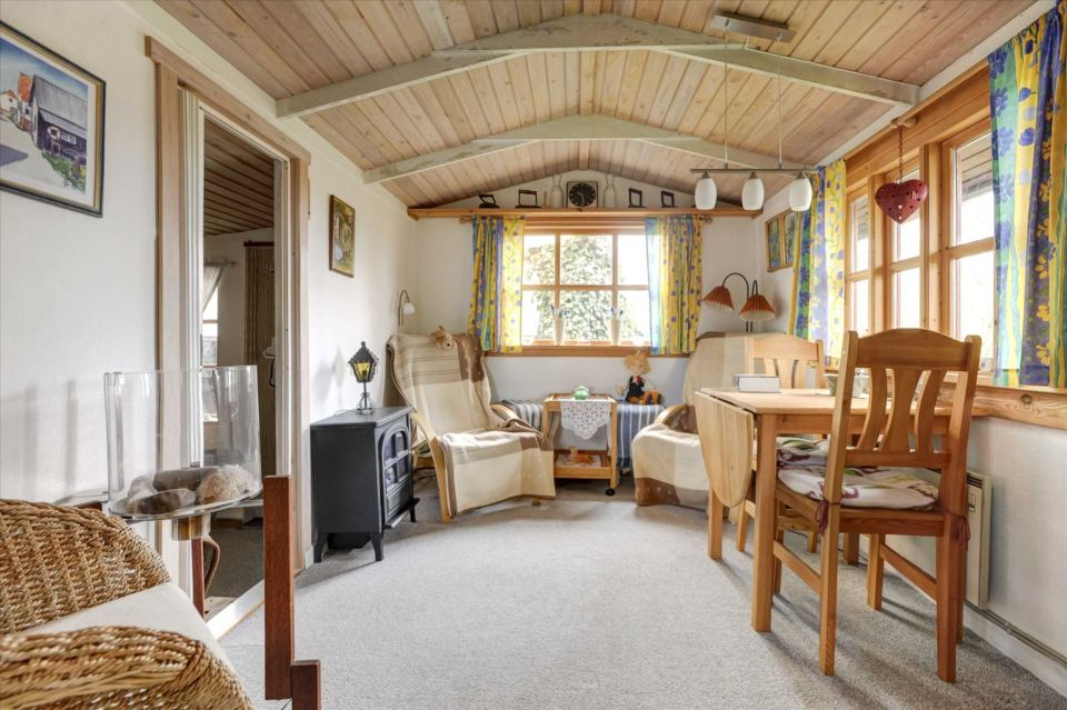 A tiny beach cottage in Denmark with one bedroom in only 280 sq ft. | www.facebook.com/SmallHouseBliss