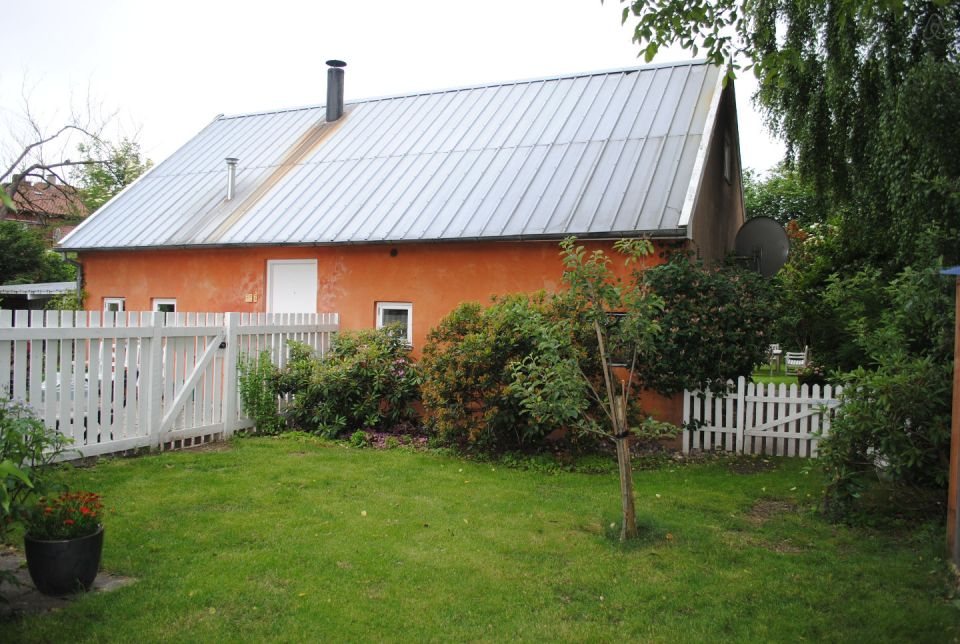 This cottage in Denmark opens to a lushly-planted garden. It is 861 sq ft with a loft bedroom and the potential for a second bedroom downstairs. | www.facebook.com/SmallHouseBliss