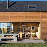 """This New Zealand """"bach"""" (a simple vacation home) has a 592 sq ft main level plus two attic loft bedrooms. 