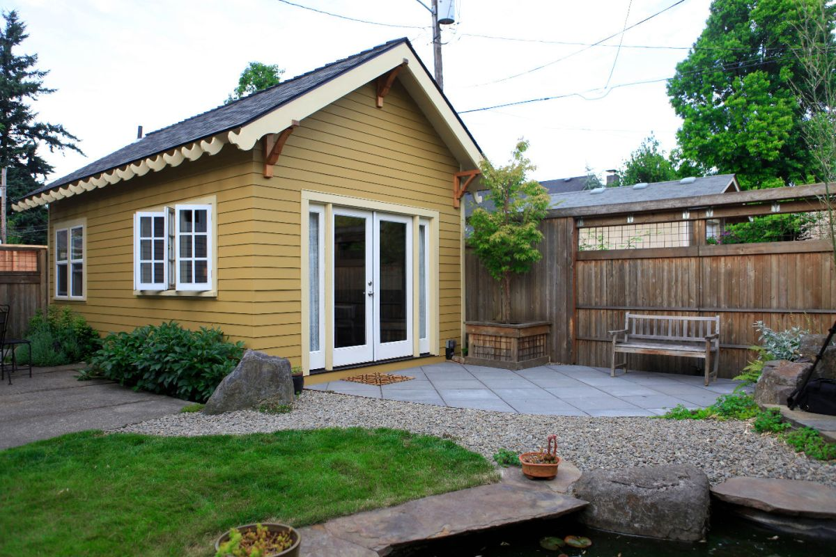 The piedmont cottage a tiny backyard cottage in portland for Small backyard cabin