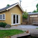 This tiny backyard cottage in Portland, Oregon, is likely a converted garage. It has 300 sq ft plus a sleeping loft. | www.facebook.com/SmallHouseBliss