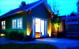 This tiny backyard cottage in Portland, Oregon, is likely a converted garage. It has 300 sq ft plus a sleeping loft.   www.facebook.com/SmallHouseBliss