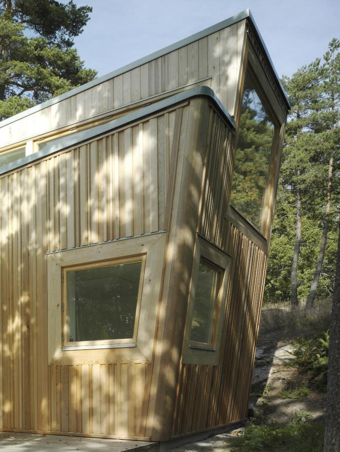 This low-impact modern cabin in Sweden has two bedrooms and a loft in 646 sq ft. | www.facebook.com/SmallHouseBliss