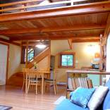 Artwood Cottage, a cozy hideaway in the woods, features hand-plastered walls and custom woodwork. It has one lofted bedroom. | www.facebook.com/SmallHouseBliss