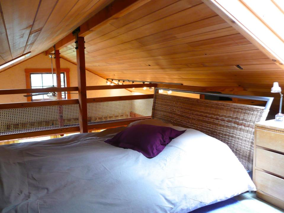 Artwood Cottage, a cozy hideaway in the woods, features hand-plastered walls and custom woodwork. It has one lofted bedroom.   www.facebook.com/SmallHouseBliss