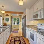 A Craftsman-style float house in Seattle's Portage Bay with two bedrooms in 960 sq ft. | www.facebook.com/SmallHouseBliss