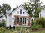 """This traditional """"Katrina Cottage"""" design has 3 bedrooms in 1,112 sq ft. 