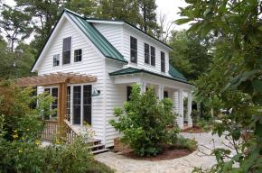 "This traditional ""Katrina Cottage"" design has 3 bedrooms in 1,200 sq ft. 
