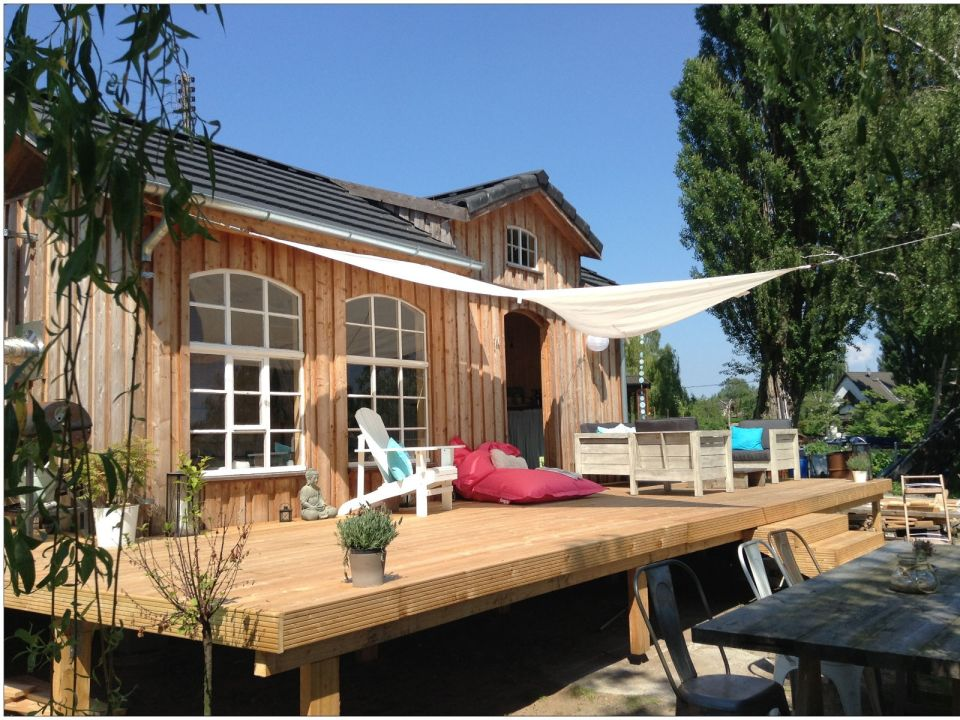 This small garden cottage located in an allotment garden has a kitchenette, half bath and sleeping loft in 258 sq ft.   www.facebook.com/SmallHouseBliss