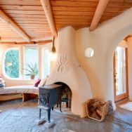 A one-bedroom storybook cottage with curved walls sculpted from cob, a mixture of clay, sand and straw. | www.facebook.com/SmallHouseBliss