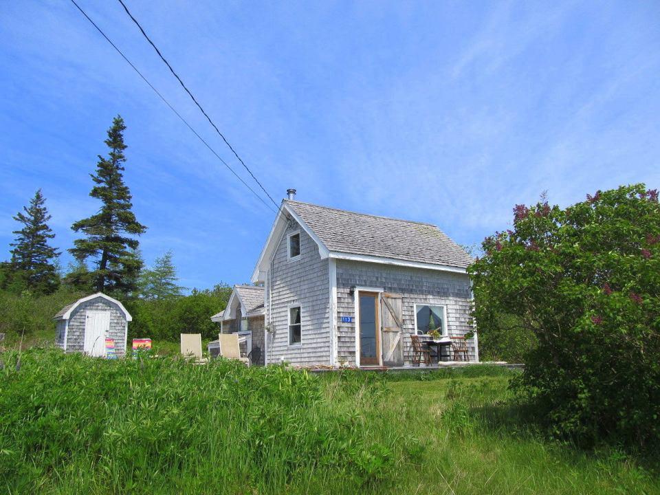 A vernacular coastal cottage on Grand Manan Island, New Brunswick.   www.facebook.com/SmallHouseBliss