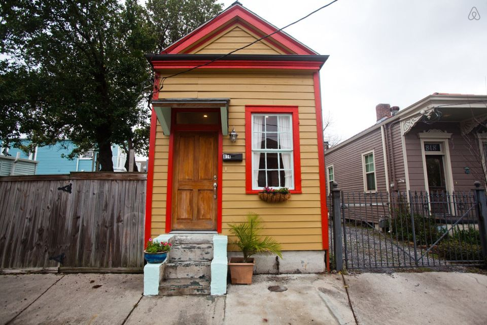 "A tiny ""shotgun"" cottage in the Irish Channel neighborhood of New Orleans. It has one bedroom in roughly 400 sq ft. 