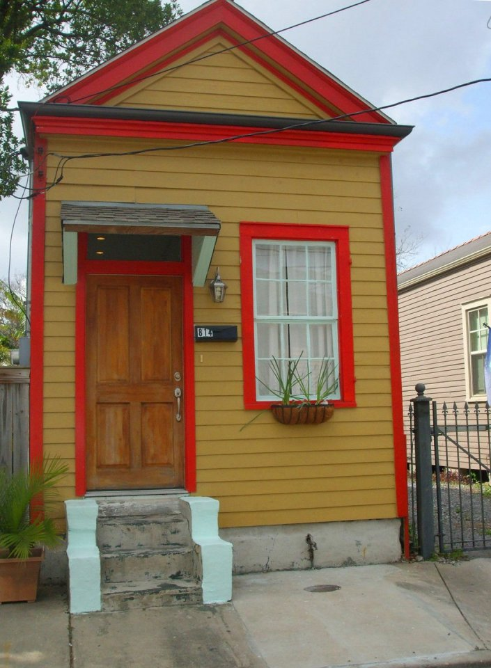 """A tiny """"shotgun"""" cottage in the Irish Channel neighborhood of New Orleans. It has one bedroom in roughly 400 sq ft. 
