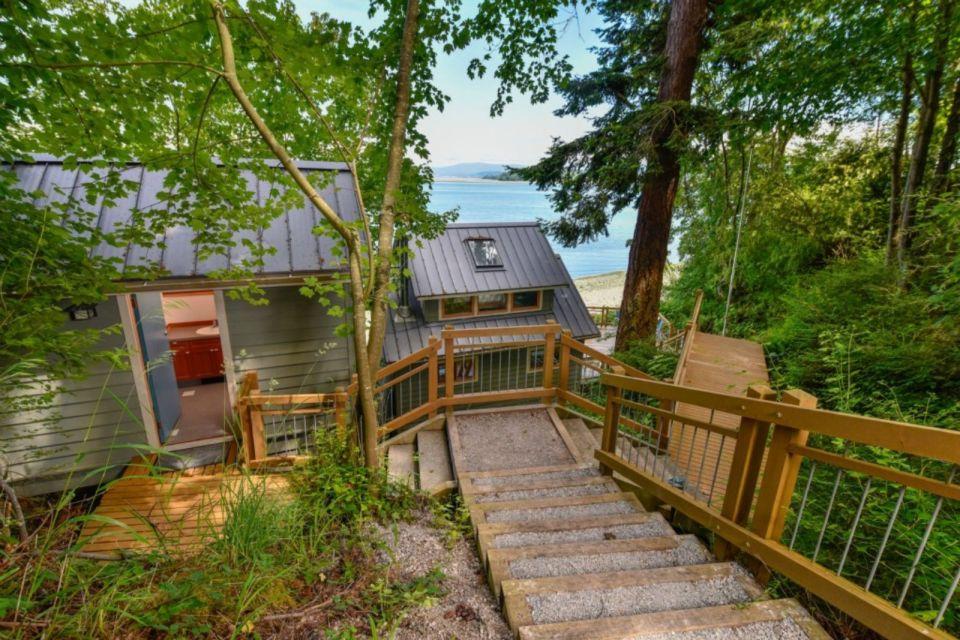 A tiny cottage on Washington's Lummi Island. The 458 sq ft cottage has a distinctive roof lantern to accommodate a loft bedroom. | www.facebook.com/SmallHouseBliss
